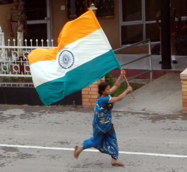 Indian woman runs with flag
